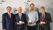 The three winners of the Global Economy Prize 2018 show their medals, Dennis J. Snower joins them for the picture