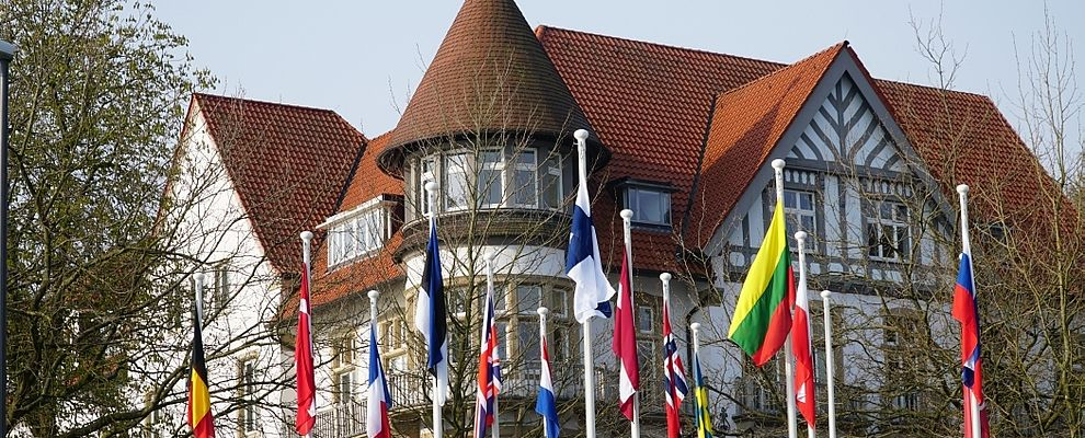 Colorful, international flags in front of the Kiel Institute.