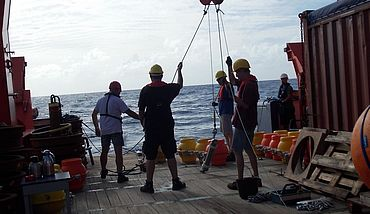 Workers on a ship ready to release buoys