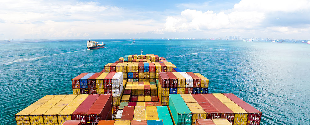 View over cargo ship deck with containers