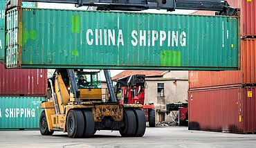 China Shipping container transported in harbor