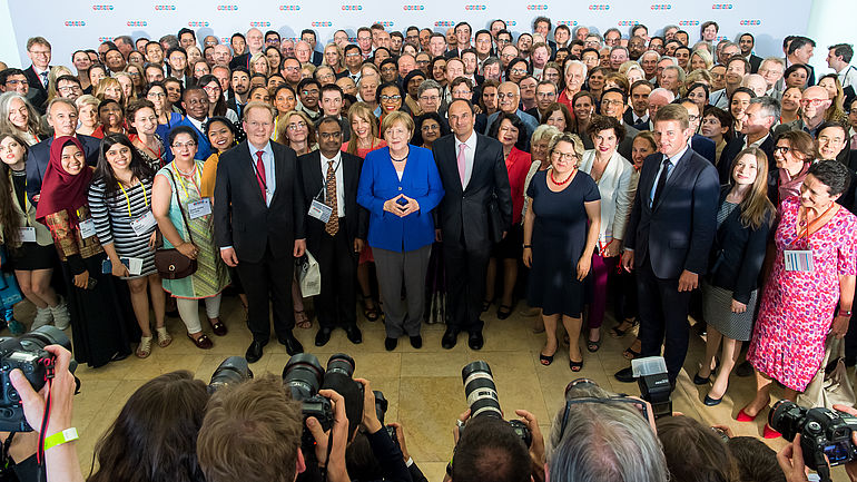 Global Solutions Summit 2018 group photo with Angela Merkel