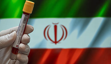 Flag of Iran with positive Covid-19 test tube