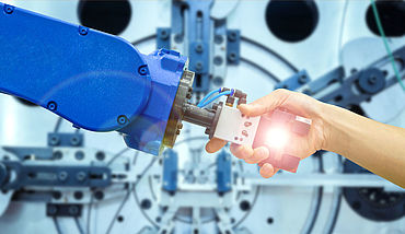 Industrial robot handshake with human on relationship for working on industrial manufacturing in concept industrial 4.0, on flare filter and blurred machinery working on blue tone background